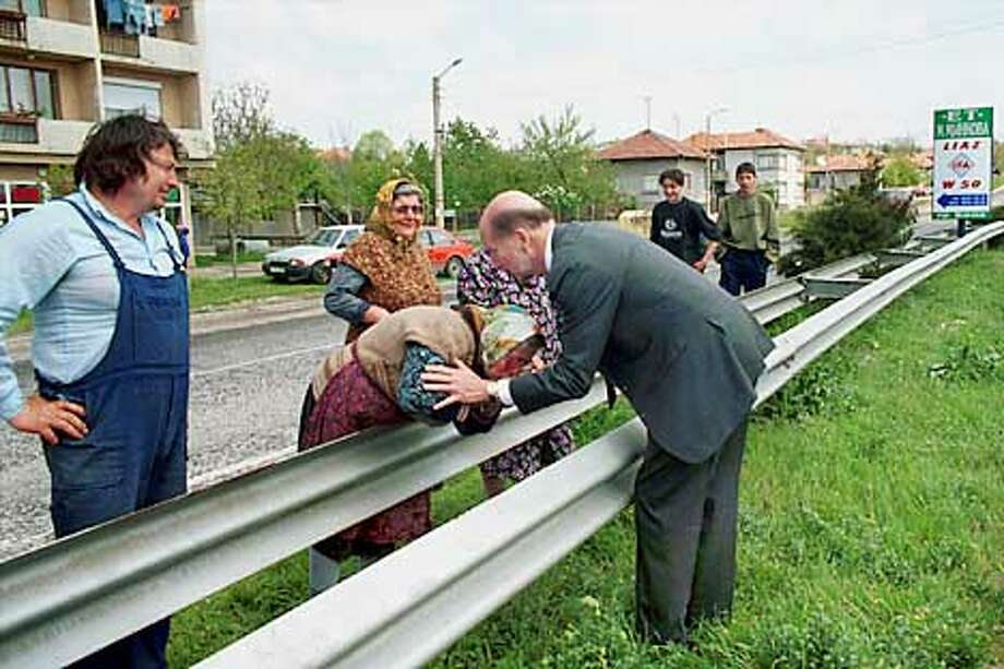 Northern Bulgaria 04/12/01 - Tsar Simeon II (Simeon Borisov Sakskoburggotski), King of Bulgaria, greets some of his supporters in the middle of the highway en route to Sofia from Rousse. This week, he announced the formation of a new political party called the Simeon II National Movement which will field candidates in Bulgarian elections scheduled for June.  Credit: Thorne Anderson/Corbis Sygma Photo: Thorne Anderson