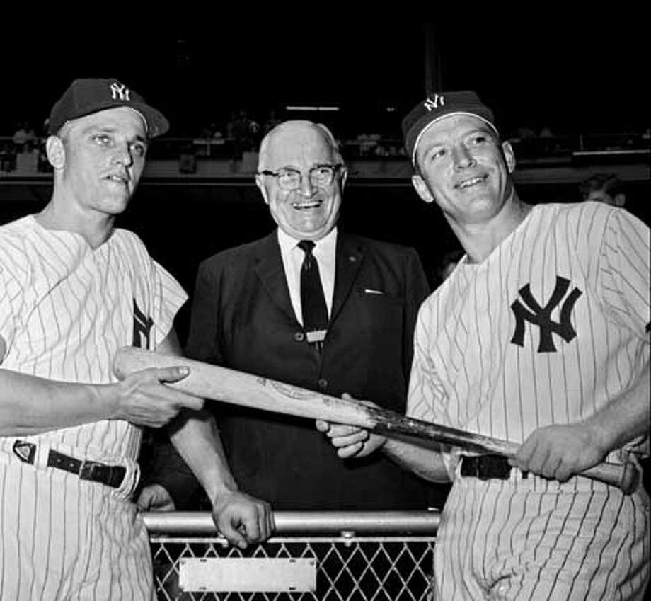 FILE--Former President Harry S Truman is flanked by Yankees Roger Maris, left, and Mickey Mantle between games in a doubleheader with the Washington Senators Sept. 4, 1961 at Yankee Stadium. At the time Maris had 53 home runs and Mantle 50 in their head-o-head race for Babe Ruth's record of 60 homers in one season. Maris won it. Mantle died Sunday Aug. 13, 1995 of cancer. (AP Photo/file)