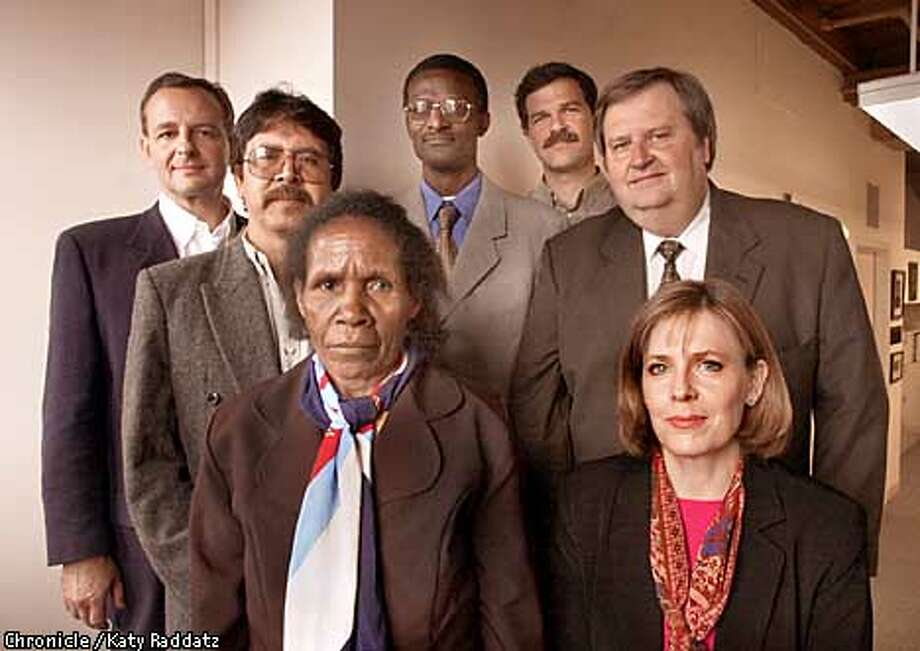 Photo by Katy Raddatz--The Chronicle  the Goldman Prize for environmental achievment will be awarded to these seven people at the Goldman Foundation on Monday, April 23, 2001. SHOWN left to right: Bruno Van Peteghem (New Caledonia-Island Nations), Gabriel Herbas (Oscar Olivera's representative from Bolivia-So. America), Yosepha Alomang -short lady in front row-(Indonesia-Asia), Eugene Rutagarama-black man with glasses-(Rwanda-Africa), Giorgos Catsadorakis -next to Eugene-(Greece-Europe), Steve Wilson and Jane Akre (husband wife team from Florida-No. America). Photo: KATY RADDATZ