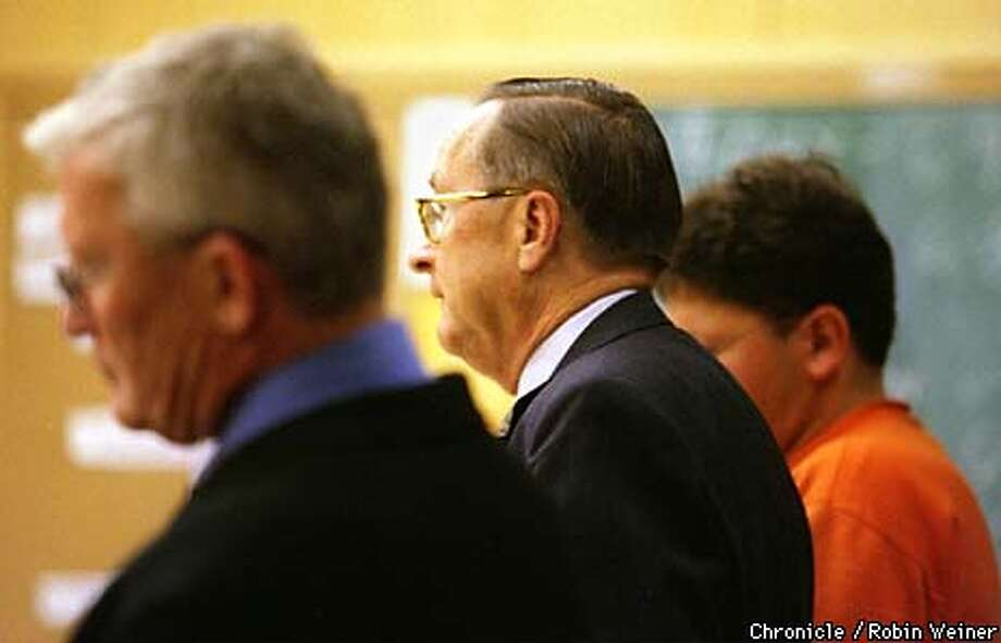 Attorney Edward Pliska, center, who is defending Jehad Baqlah, right, listens to Judge Kevin Ryan along with district attorney Terrence Hallinan, left, during an arraignment for Baqlah at San Francisco's Hall of Justice regarding Julie Day's death last week. BY ROBIN WEINER/THE CHRONICLE Photo: ROBIN WEINER