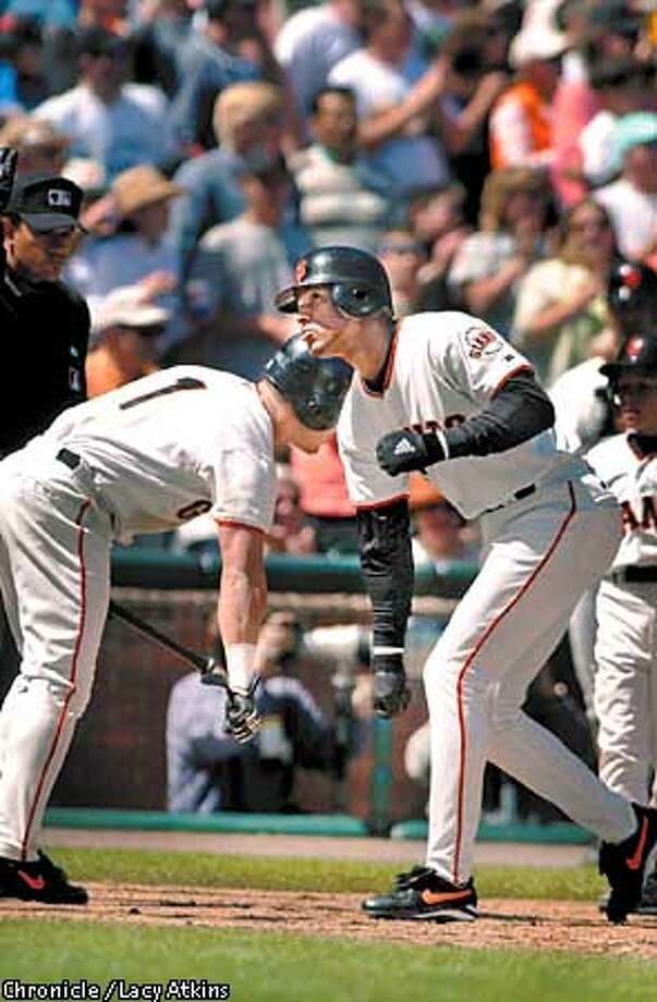 GIANTSb-C-22APR01-SP-LA  Giants Armando Rios greets Eric Davis at homeplate after Davis hits a homerun with two players on base in the fifth inning against Milwaukee, Sunday April 22,01. Davis homerun tied up the game.  Photo By Lacy Atkins/San Francisco Chronicle Photo: Lacy Atkins
