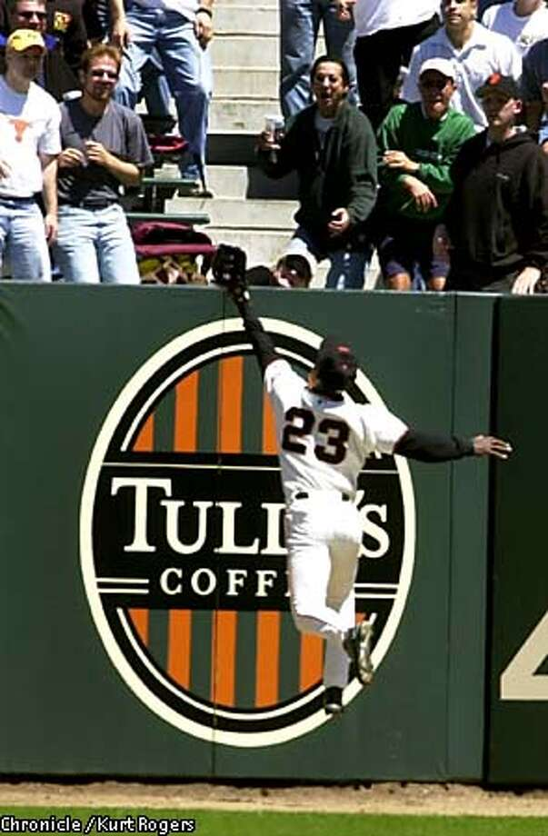 Giants center fielder Shawon Dunston hit the wall and dropped the ball as Milwaukee's Henry Blanco got a triple. Chronicle photo by Kurt Rogers