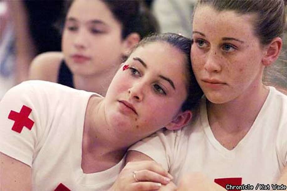 Walnut Creek Intermediate 8th grader, Rachael Mazer, 13, (left) leans on the shoulder of her friend Jessica Broda, 13, while they listen to a poem about Kosova. These girls and their friends personally collected over $3,000 of the $31,000 collected by local school children to donate to the Red Cross for Kosova. SAN FRANCISCO CHRONICLE PHOTO BY KAT WADE Photo: KAT WADE