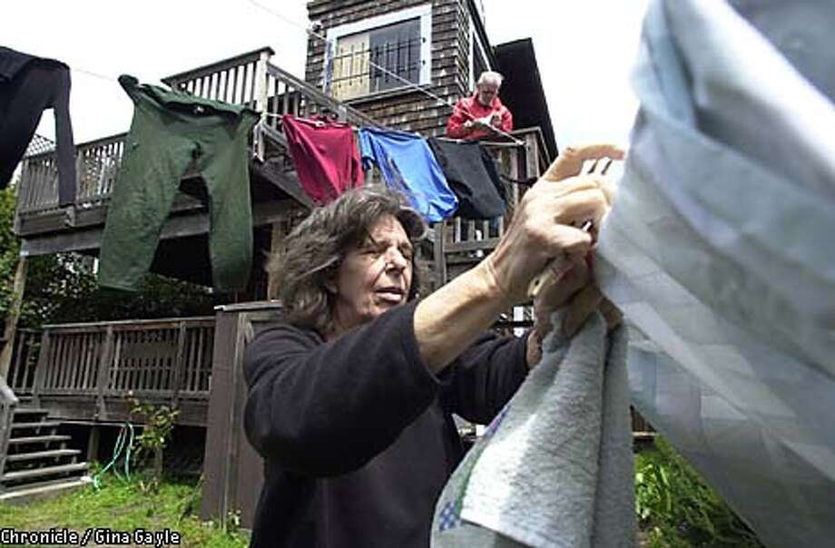 Mina and Tom Caulfield hung laundry on backyard clotheslines in Berkeley, a method that certainly saves energy but hasn't created enough heat to become common behavior in the Bay Area. Chronicle photo by Gina Gayle