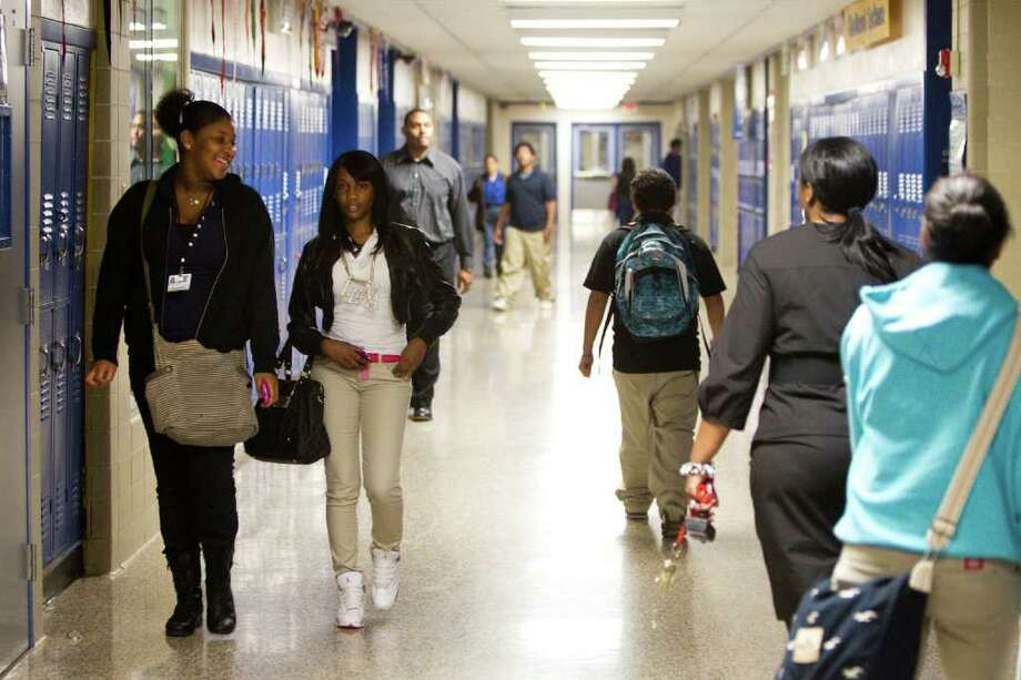 Students at Booker T. Washington High School walk the hallway between classes in Houston. Enrollment at city's first African-American high school, with a renowned engineering program, has fallen to a historic low. Photo: Brett Coomer, Houston Chronicle / © 2012 Houston Chronicle