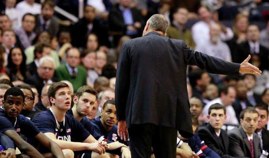 Connecticut head coach Jim Calhoun talks to his team during the first half of an NCAA college basketball game against Georgetown, Wednesday, Feb. 1, 2012, in Washington. (AP Photo/Haraz Ghanbari) Photo: Haraz Ghanbari/Associated Press / AP