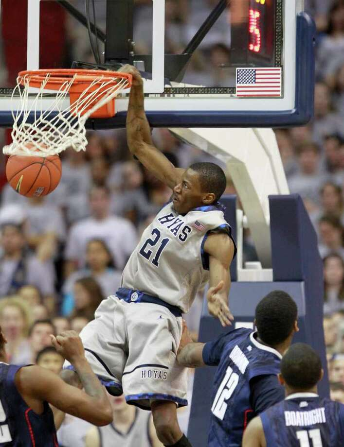 Georgetown's Jason Clark dunks during the first half of an NCAA basketball game against Connecticut, Wednesday, Feb. 1, 2012, in Washington. (AP Photo/Haraz Ghanbari) Photo: Haraz Ghanbari, Associated Press / AP