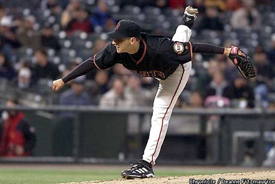 Starting pitcher Russ Ortiz, combined with Barry Bonds' two-run homer, guided the Giants to a 3-1 victory over the Brewers at Pacific Bell Park. Chronicle photo by Deanne Fitzmaurice