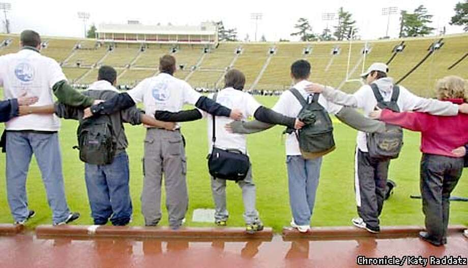 Students from Palo Alto and Gunn high schools went for the Guiness world record for largest group hug at Stanford University Stadium yesterday. Chronicle photo by Katy Raddatz