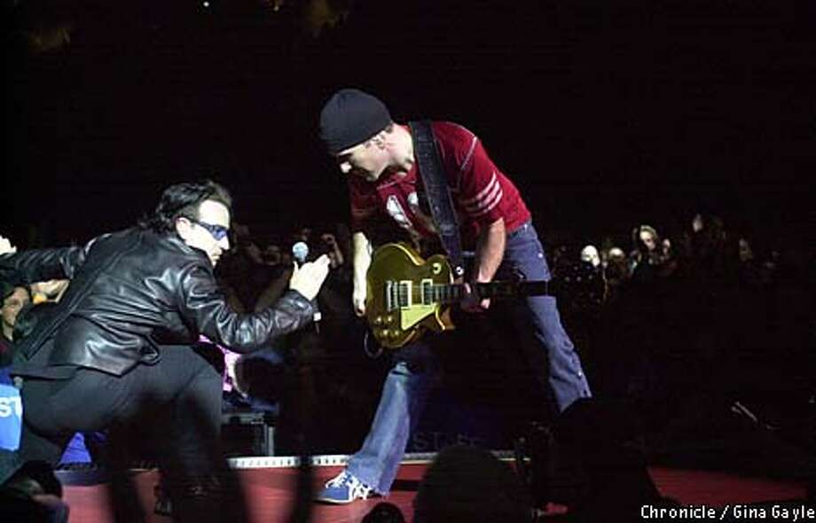 Bono and the Edge went for broke at the U2 show at Compaq Center in San Jose. Chronicle photo by Gina Gayle