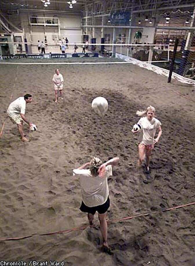 Beach volleyball is one of several indoor activities at the Beach sports club in Oakland that help keep summer alive all year. Chronicle photo by Brant Ward