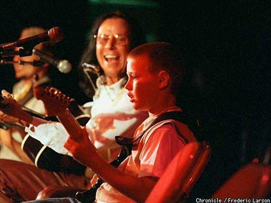 CONCERT22-1/C/20MAY99/MN/FRL: Chris Capone (10) of St Isidore Elementary in Danville plays along with professional guitarist Bruce Hock during a recital at Monte Vista H.S. in honor of Chester Farrow who is retiring after 32 years of teaching. Chronicle photo by Frederic Larson Photo: FREDERIC LARSON