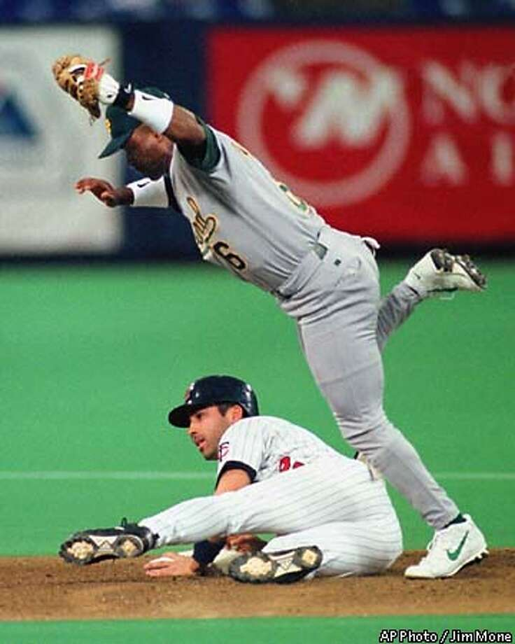 Oakland Athletics second baseman Tony Phillips steps over Minnesota Twins' Todd Walker after tagging him during a first-inning steal attempt at second base Friday night, May 21, 1999, in Minneapolis. (AP Photo/Jim Mone) Photo: JIM MONE