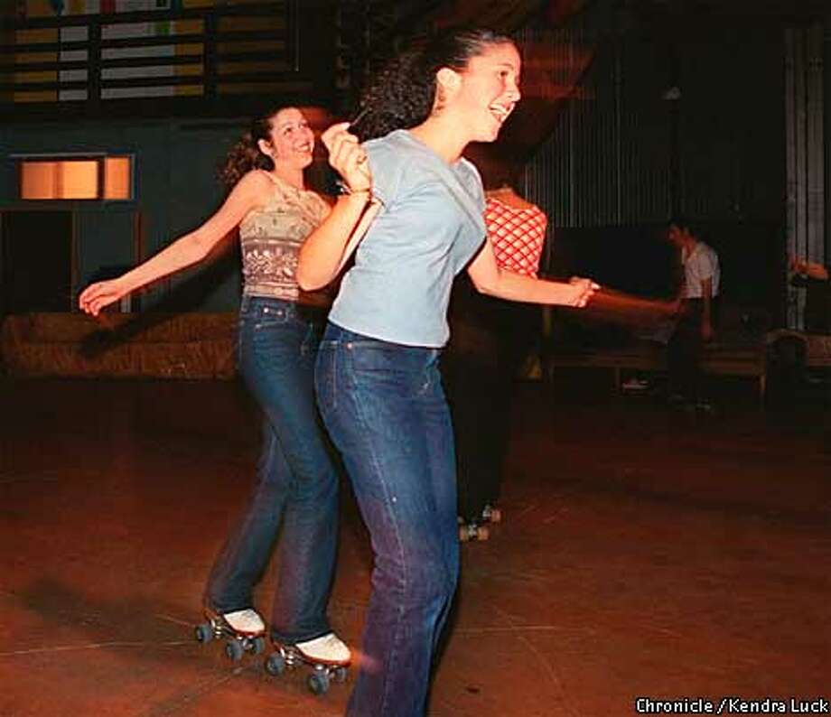 Moraea Smith and Lizzy Cole both 13 and of San Francisco skate and dance around the the makeshift skate rink, the two are regulars at the weekly skate. --The collaborative arts center Cellspace in San Francisco host the weekly Tuesday night skate in their warehouse moving the furniture to edges and turning on the music.  (KENDRA LUCK/SAN FRANCISCO CHRONICLE) Photo: KENDRA LUCK