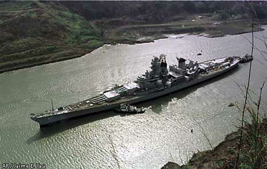 The USS Iowa crosses the Panama Canal at Gaillard Cut near Panama City, Panama Tuesday March 27, 2001. At 108.2 feet wide, the Iowa-class battleships are the largest vessels ever to scrape their way through the 110-foot-wide locks of the canal. They were designed so that they could just fit through the waterway. (AP Photo/Jaime E. Yau) Photo: JAIME E.YAU