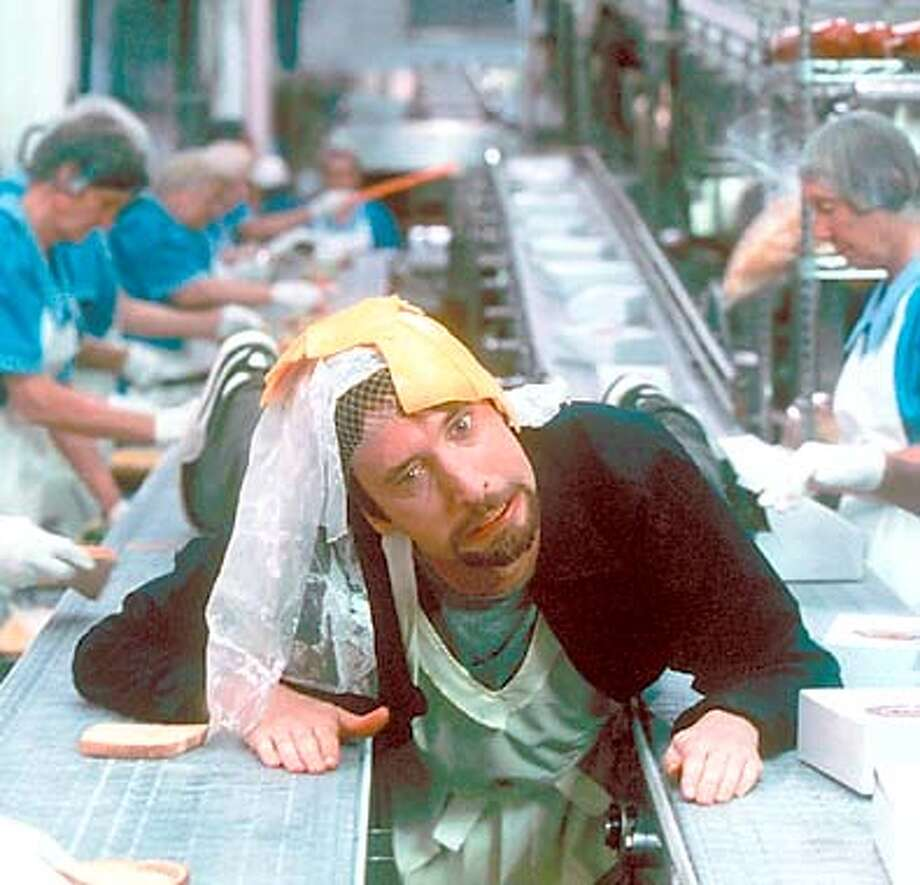 "Freddy (Tom Green) tries to break the monotony of his job at a sandwich factory in ""Freddy Got Fingered."" Handout Photo"