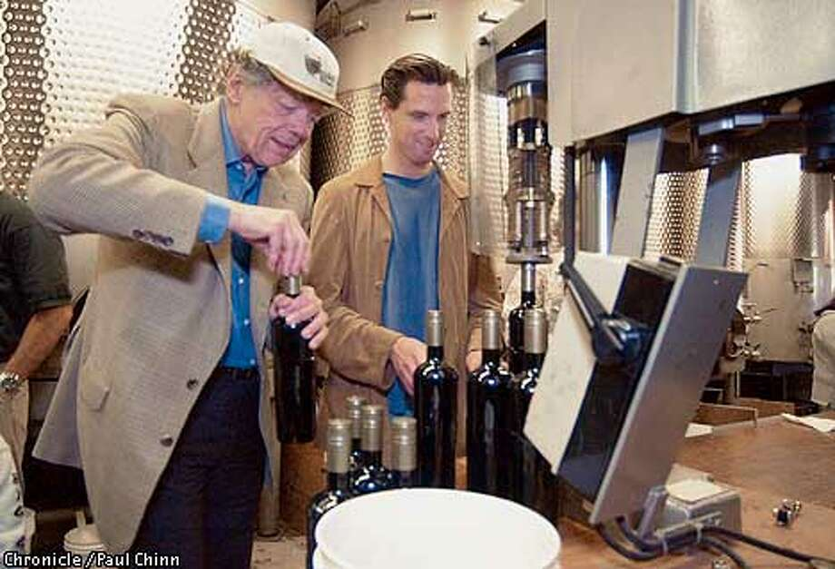 Plumpjack winery executives Gordon Getty (left) and Gavin Newsom are using screwcaps to seal bottles. PAUL CHINN/S.F. CHRONICLE Photo: PAUL CHINN