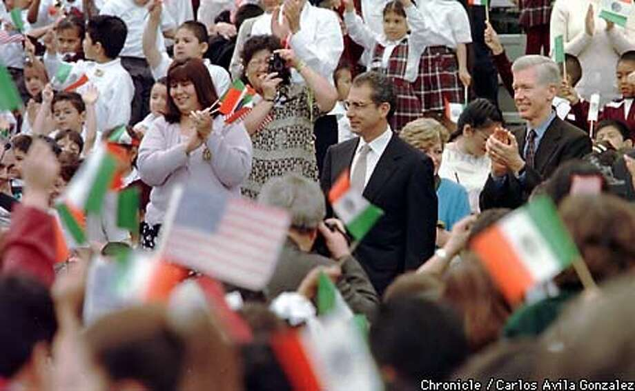 Governor Gray Davis, right, and Mexican President, Ernesto Zedillo are welcomed by cheers and waving Mexican and American flags at Breed Street Elementary School in East Los Angeles, Ca., on Thursday, May 20, 1999, the last day of Zedillo's three-day visit to California to work out business deals between California and Mexico. (CARLOS AVILA GONZALEZ/SAN FRANCISCO CHRONICLE) Photo: CARLOS AVILA GONZALEZ