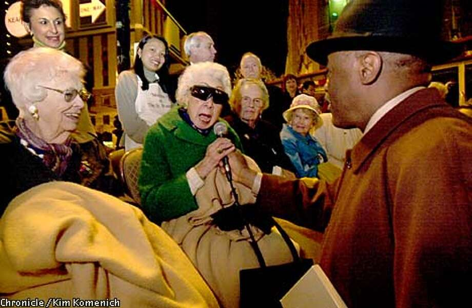 Bessie Shum, 97, a survivor of the 1906 temblor, told Mayor Willie Brown how her family reacted to the devastating quake. Chronicle photo by Kim Komenich