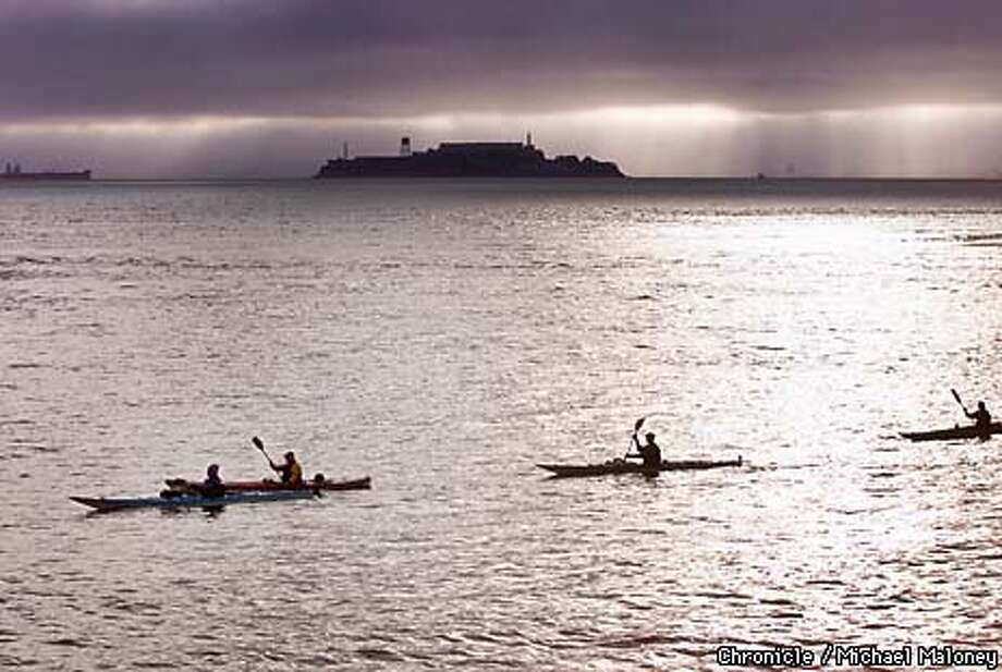 Five sea kayakers take off on a rare 6 knot ebb current from Gas House Cove near Fort Mason, past Alcatraz and the GG Bridge to Pacifica.  CHRONICLE PHOTO BY MICHAEL MALONEY Photo: MICHAEL MALONEY