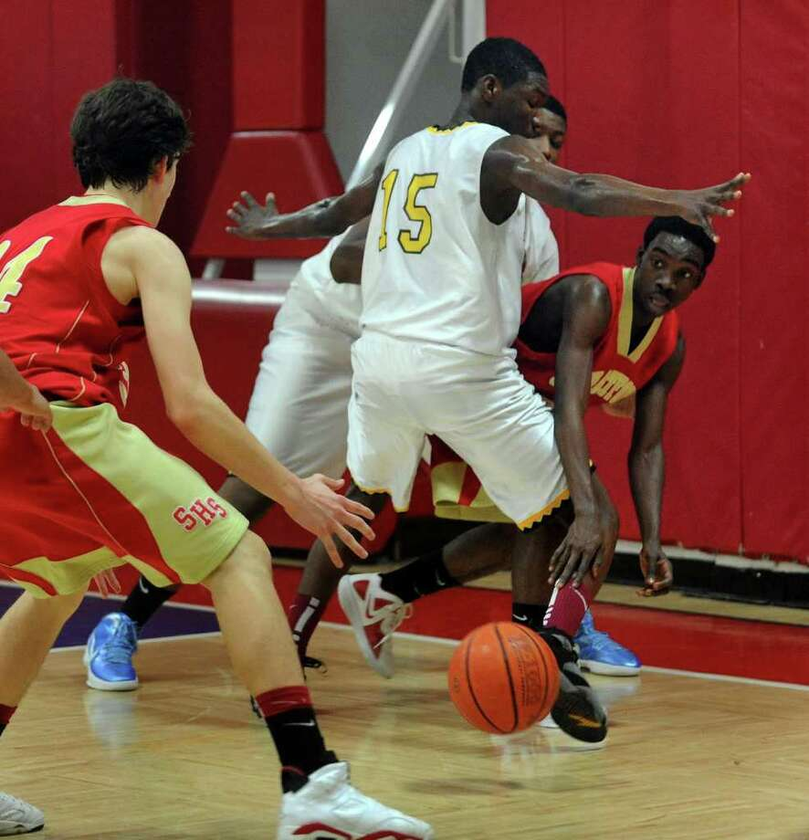 Kolbe Cathedral's #15 Ian Gardner attempts to hem in Stratford's #4 Marcus Vereen as he passes the ball to a teammate, during boys basketball action in Bridgeport, Conn. on Wednesday February 1, 2012. Photo: Christian Abraham / Connecticut Post