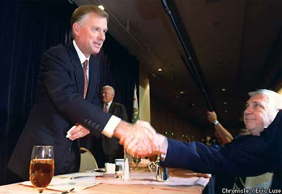 Dan Quayle, presidential hopefull canidate received congratulatory handshakes after his speech to the Commonwealth Club at the Hilton Hotel in San Francisco.  BY ERIC LUSE/THE CHRONICLE Photo: ERIC LUSE