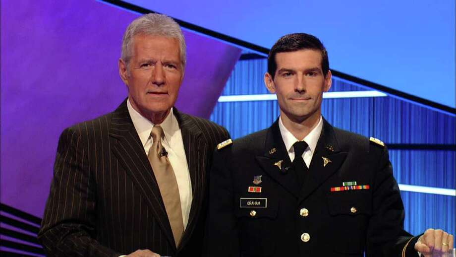 Capt. Brendan Graham, seen here with 'Jeopardy!' host Alex Trebek, is donating half of his $46,602 winnings to military charities. Photo: Courtesy Photo