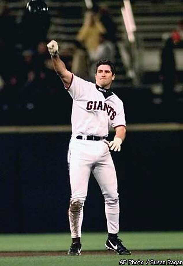 San Francisco Giants' Rich Aurilia tosses his helmet after he was stranded on second after the Giants failed to advance runners in the sixth inning Tuesday, May 18, 1999, against the Arizona Diamondbacks in San Francisco. The Diamondbacks won 12-1. (AP Photo/Susan Ragan) Photo: SUSAN RAGAN