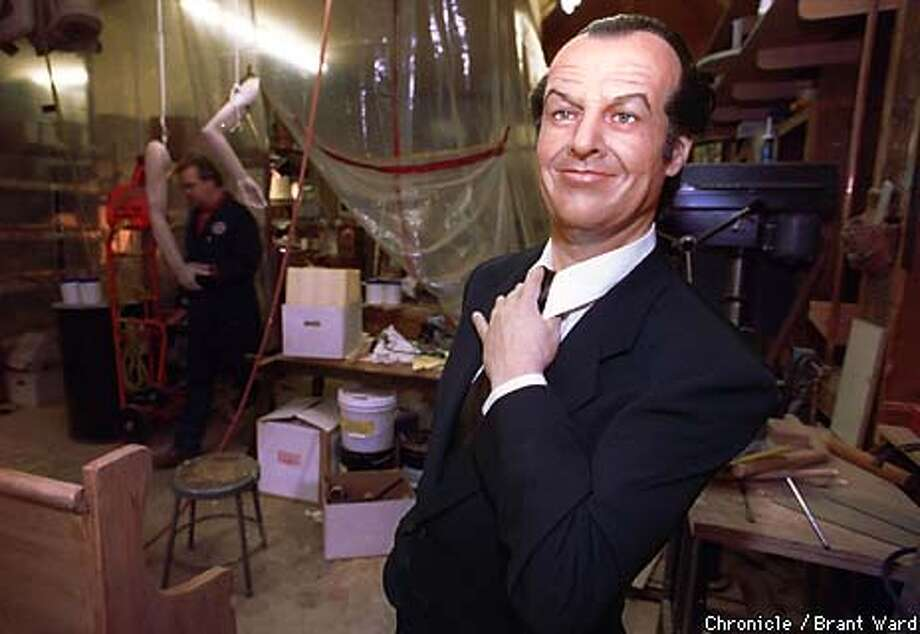 WAX1/13MAY99/MN/BW--Wax Museum curator Curtis Huber, in background, works in a cramped storage area while construction continues on the museums' new home. One of Ron Fong's newest creations, Jack Nicholson, is one of the few wax figures not in boxes. By Brant Ward/Chronicle Photo: BRANT WARD