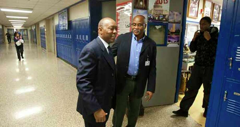 Then State-Rep. Sylvester Turner visited in January 2012 with Booker T. Washington High School football coach and U.S. history teacher Russell Austin. Turner was pushing for improvements to the school. Now, as Houston mayor, he is calling for changes to the state's school-finance system as HISD faces a budget shortfall.Continue clicking to learn the best public high schools in Texas. Photo: Nick De La Torre, Houston Chronicle / © 2012  Houston Chronicle