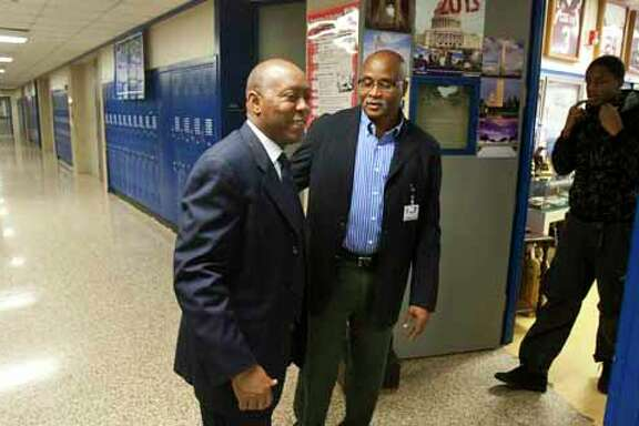 State Representative Sylvester Turner, District 139, left, visits Booker T. Washington High School football coach and U.S. History teacher Russell Austin as he visits the school, Thursday, Jan. 26, 2012, in Houston. Turner and the community  is trying to improve the school's curriculum and physical structure to keep HISD from having to close it.