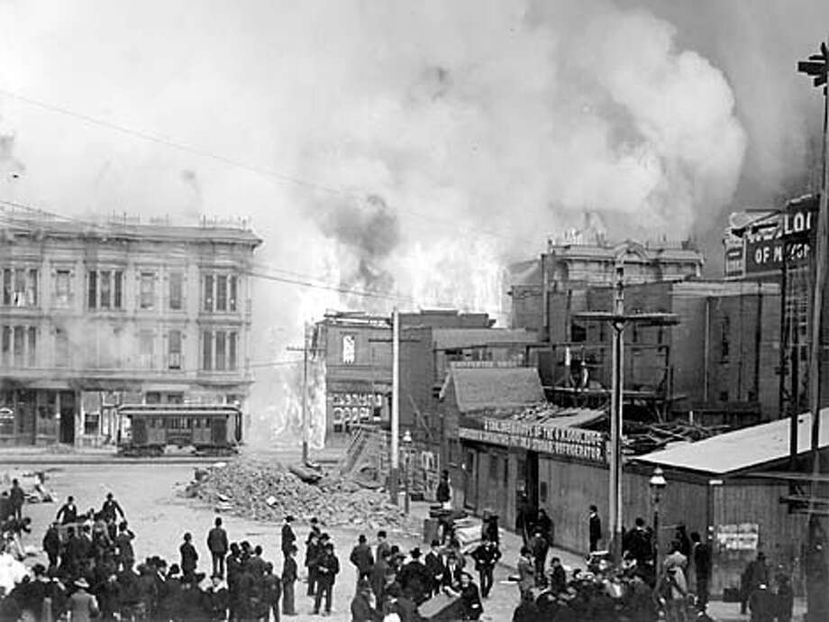 People in the Mint Street alley watched a fire burn on Mission Street between Fifth and Sixth streets after the big quake, which happened 95 years ago today. Handout Photo