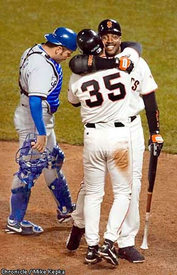 San Francisco Giant Barry Bonds is hugged by Rich Aurilia after hitting his 500 homerun. BY MIKE KEPKA/THE CHRONICLE Photo: MIKE KEPKA