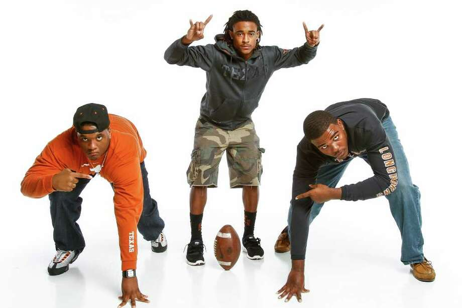 It's easy to see three area players are ready to line up and hook 'em Horns. Incoming UT recruits include, from left, Humble's Paul Boyette Jr., Clear Springs' Marcus Johnson and Pearland Dawson's Kennedy Estelle. Photo: Michael Paulsen / © 2011 Houston Chronicle