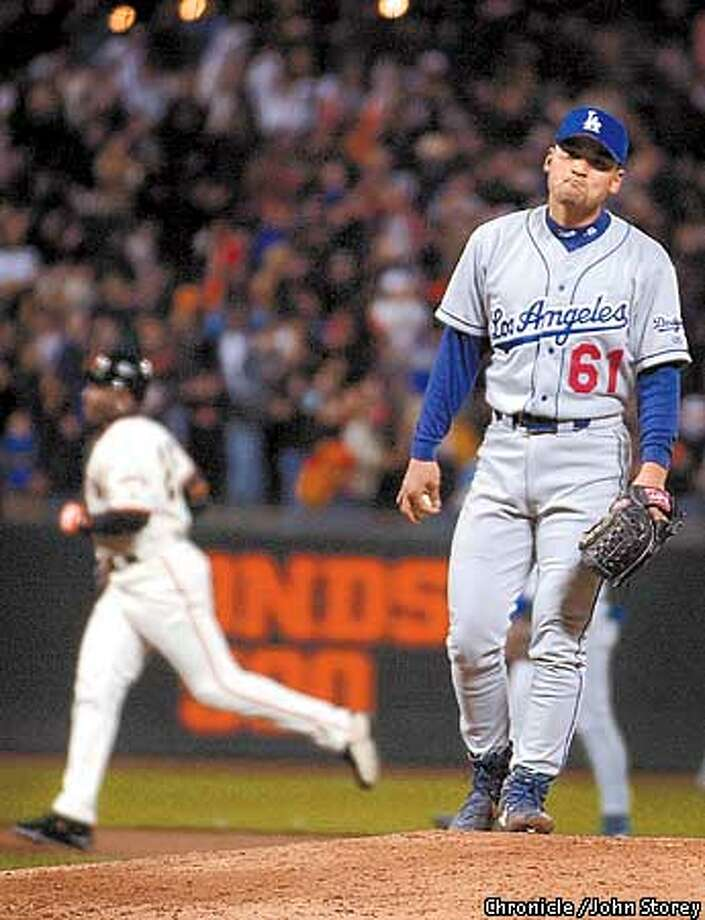 Dodger picher Chan Ho Park reacts to Barry Bonds 501st home run in the 7th inning. The Giants vs. the Dodgers at Pacific Bell Park. Photo by John Storey. Photo: John Storey