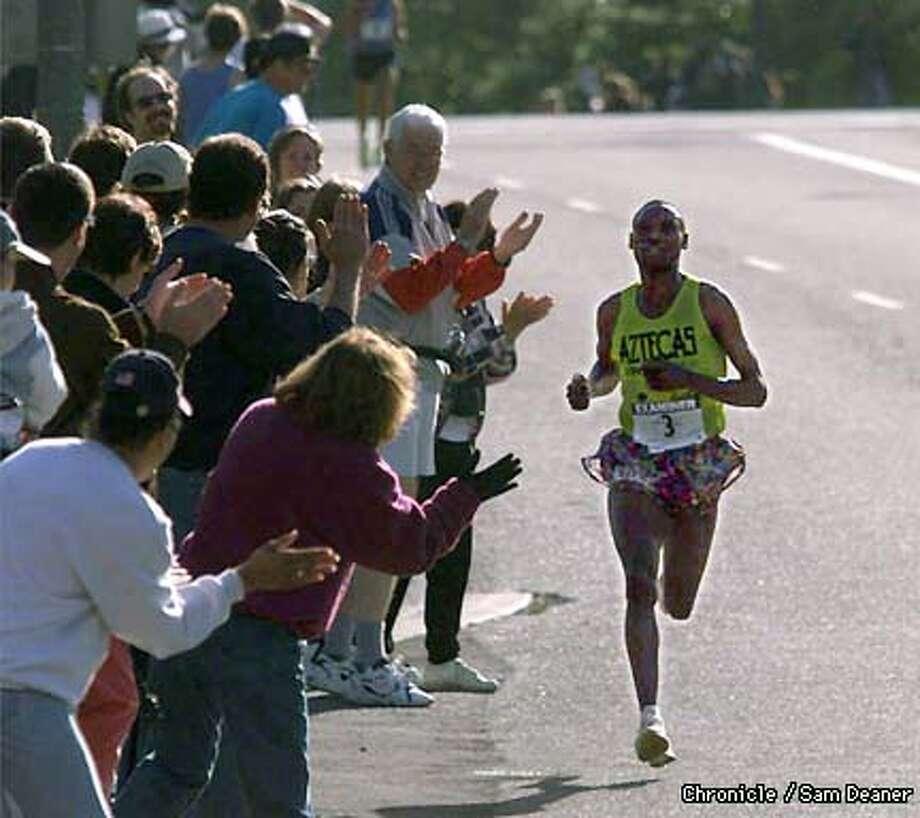 Lazarus Nyakeraka of Kenya rounds the home stretch to win Bay to Breakers Race Sunday. (CHRONICLE PHOTO SAM DEANER)
