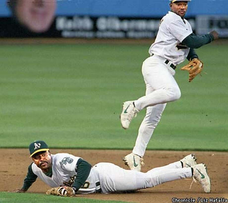 Tony Phillips looks back at first base after Jason McDonald tags Ron coomer out at 2nd dudring the 2nd inning.  BY LIZ HAFALIA/THE CHRONICLE Photo: LIZ HAFALIA