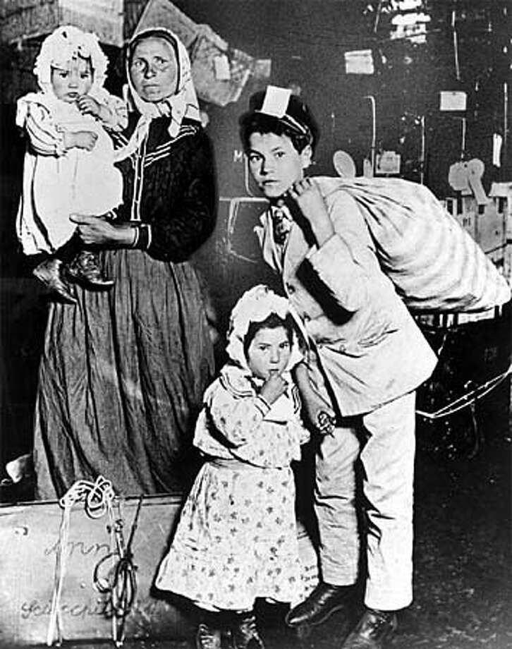 This immigrant family, like millions of others, awaited processing after arriving on Ellis Island circa 1905. Photo courtesy of New York Public Library