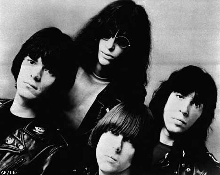 FILE--Members of the rock group the Ramones are shown in this February 1982 file photo. Singer Joey Ramone, top left, he punk rock icon whose signature yelp melded with the Ramones' three-chord thrash to launch an explosion of bands like the Clash and the Sex Pistols, died Sunday. Ramone was hospitalized in March 2001 with lymphoma. He was 49. (AP Photo/File)