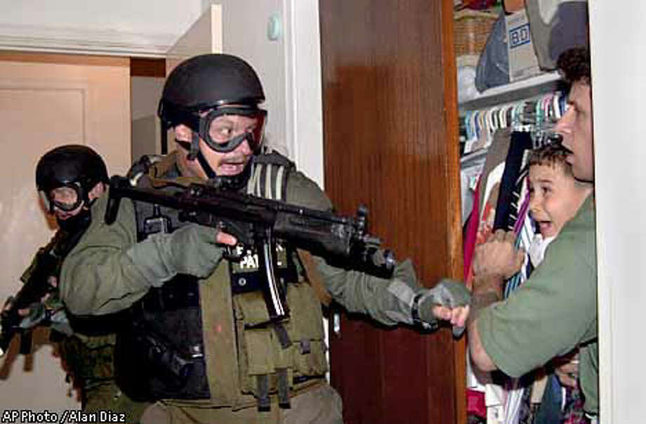 Alan Diaz, Associated Press, won the Pulitzer Prize for this photograph of a federal agent with a rifle confronting a screaming Elian Gonzalez, being held in a closet by Donato Dalrymple, who had helped pull the boy from the Atlantic five months earlier
