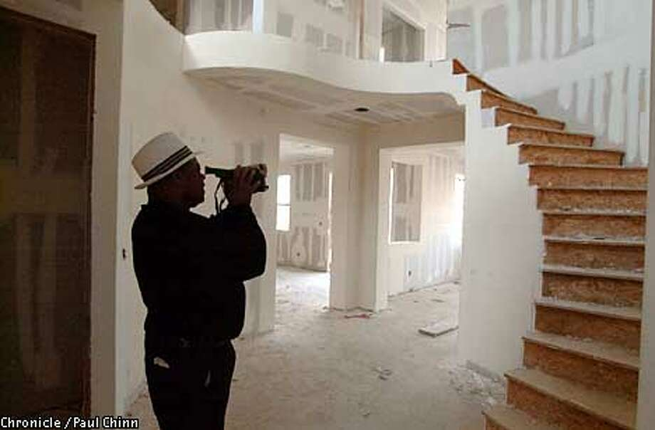 Lester Thomas videotaped the spiral staircase of the spacious new home he bought which is still under construction at the Sterling Knolls development in Antioch. PAUL CHINN/S.F. CHRONICLE Photo: PAUL CHINN