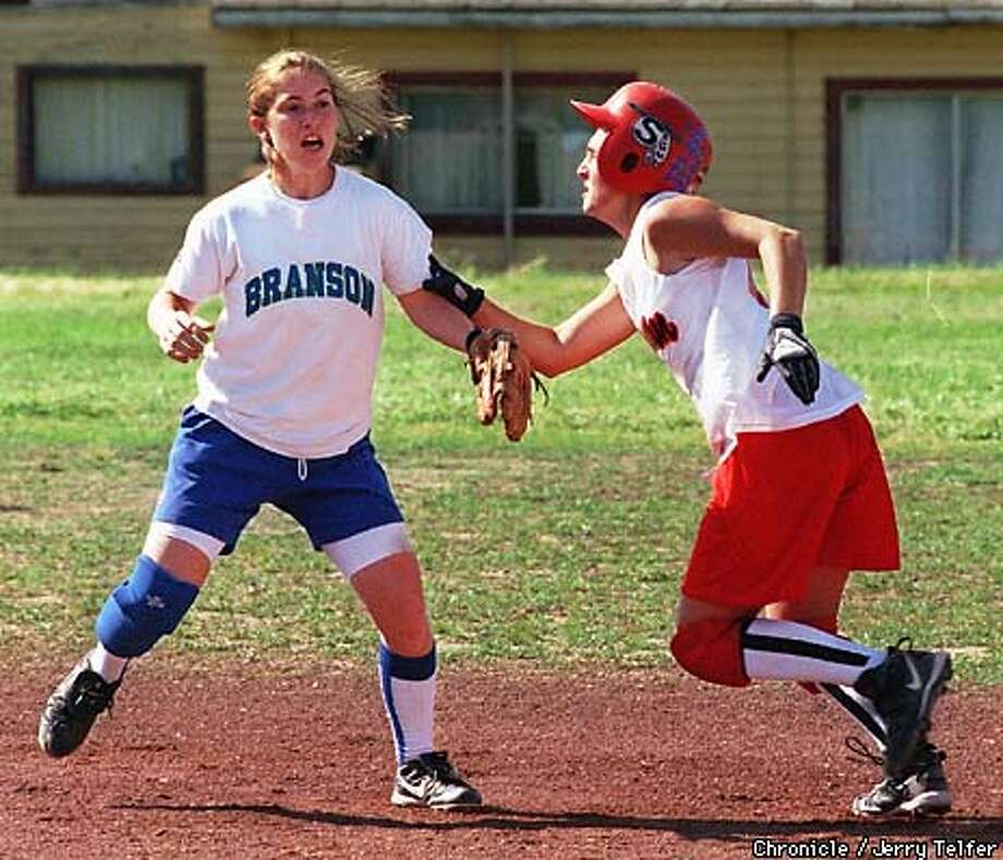 Salesian High School catcher Stephanie Vasarhely (right) rounds 2nd base in a game against Branson High.  Salesian High School - Richmond, CA  BY JERRY TELFER/THE CHRONICLE Photo: JERRY TELFER