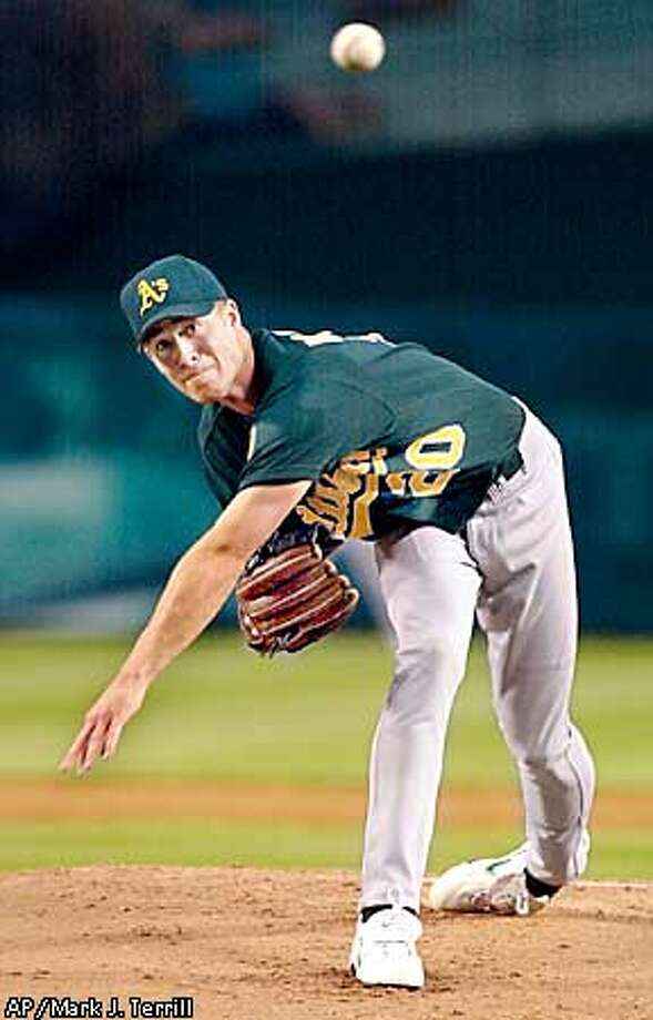 Oakland Athletics pitcher Mark Mulder throws to the plate during the first inning against the Anaheim Angels, Monday night, April 16, 2001, in Anaheim, Calif. (AP Photo/Mark J. Terrill) Photo: MARK J. TERRILL