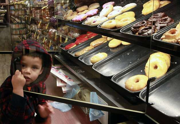 Alberto Calderon age 2 shops for donuts at a Redwood City Market Wednesday, February 1, 2012. Three UCSF scientists have published a paper that claims compulsive sugar consumption, and not obesity, that is driving up rates of diabetes and heart disease in addition to a number of other chronic, life-threatening conditions, they say. That makes sugar a significant public health danger. Photo: Lance Iversen, The Chronicle