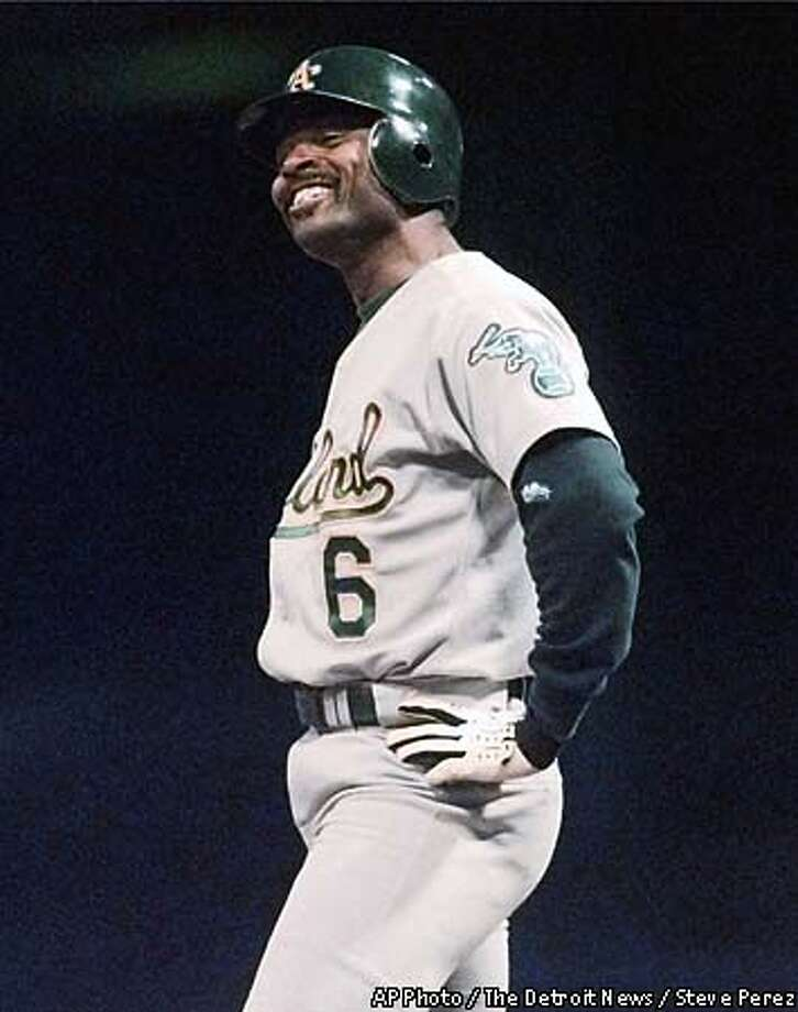 Oakland Athletics' Tony Phillips laughs at first base after being struck by a pitch in the seventh inning, Wednesday May 12, 1999, by Detroit Tigers starting pitcher Justin Thompson at Tiger Stadium in Detroit. (AP Photo/The Detroit News,Steve Perez) Photo: STEVE PEREZ
