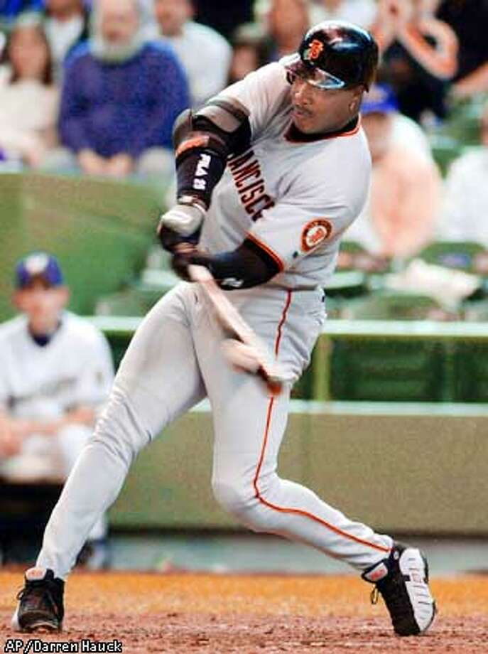 San Francisco Giants' Barry Bonds hits his 499th home run against Milwaukee Brewers pitcher David Weathers in the eighth inning Sunday April 15, 2001 in Milwaukee. (AP Photo/Darren Hauck) Photo: DARREN HAUCK