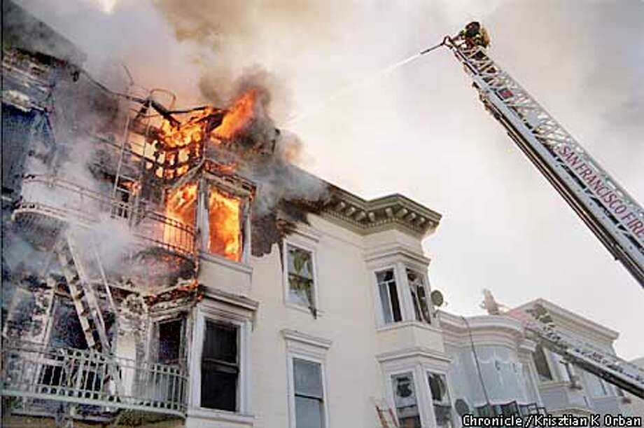 Firefighters battle a blaze at a residential hotel on Howard Street that went to four alarms on Sunday morning, April 15, 2001. About 100 people were displaced by the blaze, with only minor injuries reported.  (BY Krisztian K Orban/FOR THE SAN FRANCISCO CHRONICLE; ONE-TIME USE ONLY, MUST CONTACT FOR ADDITIONAL USE...(650) 624-9544) Photo: Krisztian K Orban