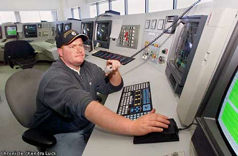 Brandon Banks a controller/operator at the solar power plant owned by KJC Operating Company at Kramer Junction in Boron Ca. watches production levels from the main control booth for the site. (KENDRA LUCK/SAN FRANCISCO CHRONICLE) Photo: KENDRA LUCK