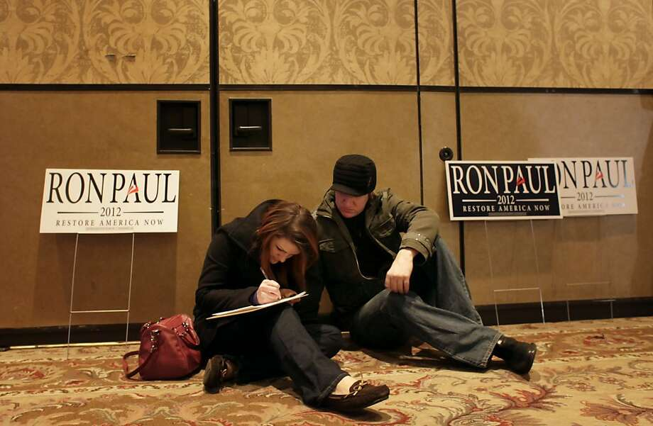 "Kyrsten Noecker and Jarrod Burton sign up to support Ron Paul as they wait to hear him address the crowd as he launches his  campaign for the Nevada caucus, Tuesday January 31, 2012, in Las Vegas, Nevada. "" I don't see anyone else looking at issues that affect us everyday,"" says Burton. Photo: Lacy Atkins, The Chronicle"