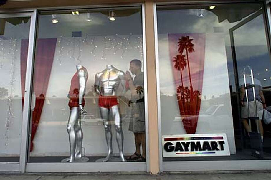 Curtis Rottenger dressed a window at Gaymart, a clothing store in Palm Springs. Chronicle photo by Chris Stewart